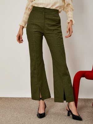 Ghospell High waisted trousers in a striped green cotton fabric. Featuring a flared leg with front splits.