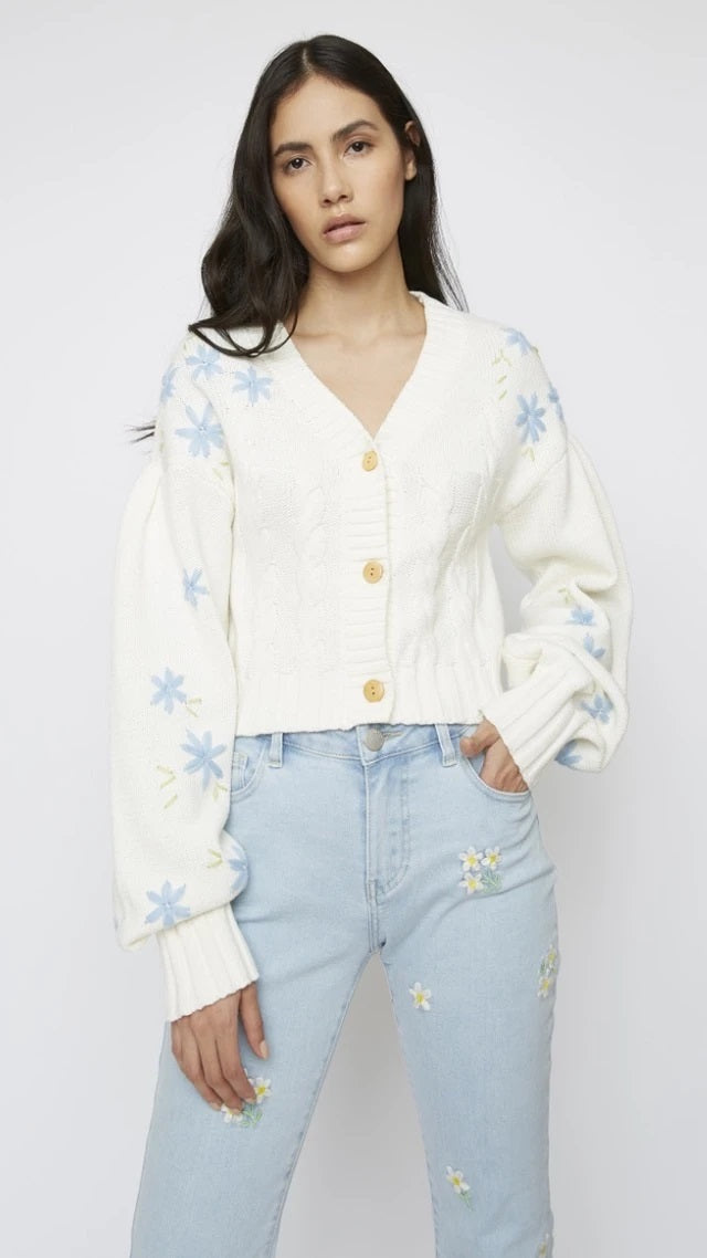 Glamorous gives a classic cable knit cardigan an on-trend boost with pale blue floral embroidery, puff sleeves and cropped vibe. Complete the look with  denim and trainers for an effortlessly chic look.