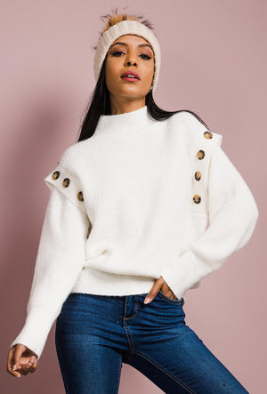 White Ribbed Knit Sweater with turtle neck featuring button detail around shoulders.