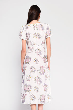 White / lilac floral midi dress with front split, featuring a stylish lace V-neck and soft short puff sleeves.