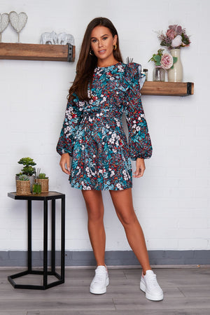 Jennifer Girl in Mind blue floral mini skater dress with long sleeves.