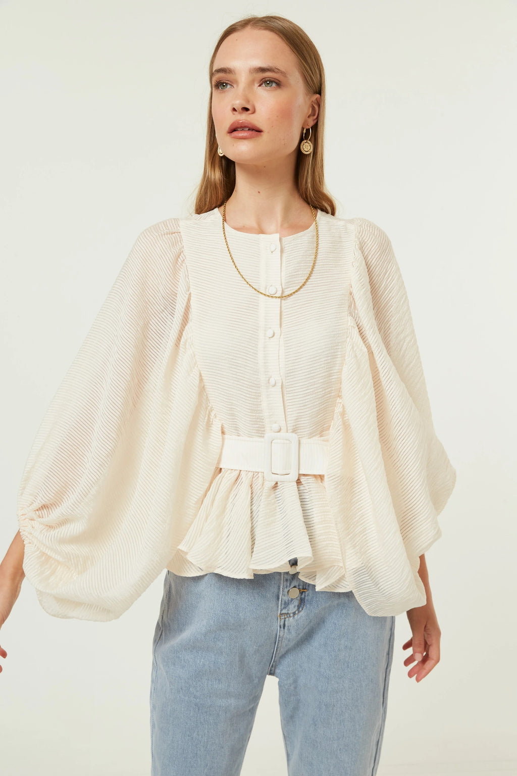 Jovonna London light yellow round neck balloon sleeved blouse with full length sleeves with elastic, featuring peplum detail  with waist belt.