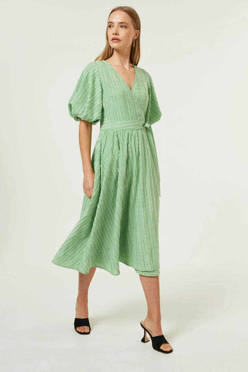 Jovonna London Classic subtle stripe wrap dress with a tie waist, V-neck in a midi length featuring voluminous sleeves finishing just above the elbow. The most gorgeous shade of light green.