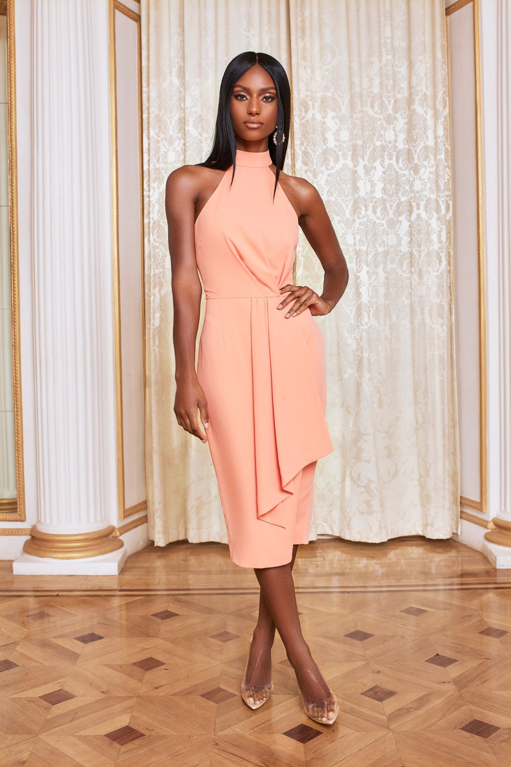 Lavish Alice high neck midi dress in light cantaloupe. This feminine and elegant piece, featuring romantic drape detailing is the perfect look for weddings, summer parties and occasions.