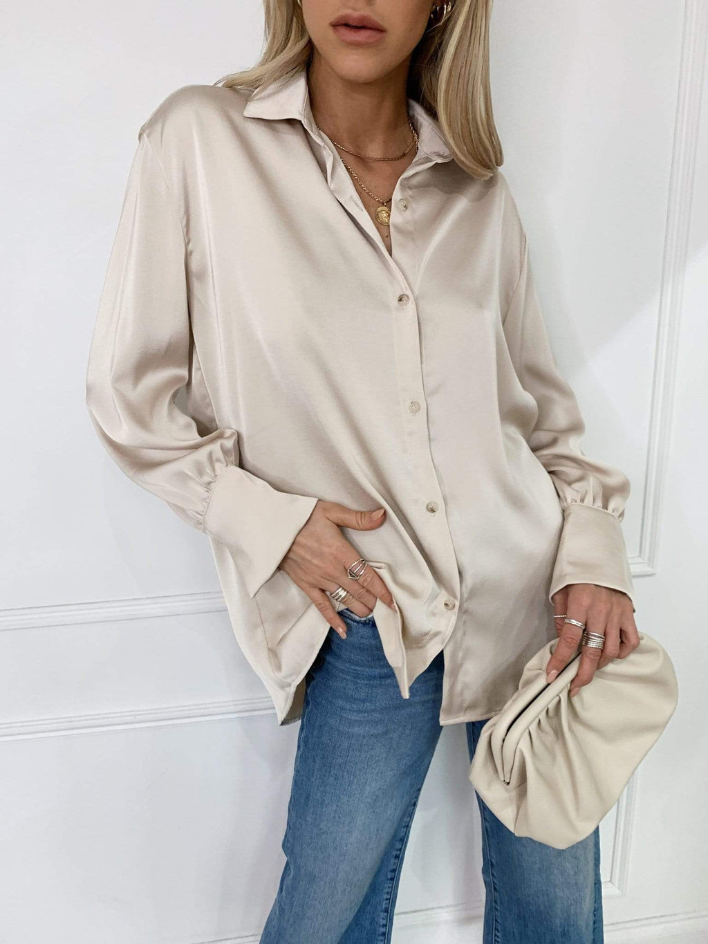 Pretty Lavish shirt cut from a soft satin material. Designed with fluted sleeves and finished with tortoise shell buttons for those extra loved details. The relaxed silhouette makes this style endlessly versatile. Style yours with jeans or leather trousers.