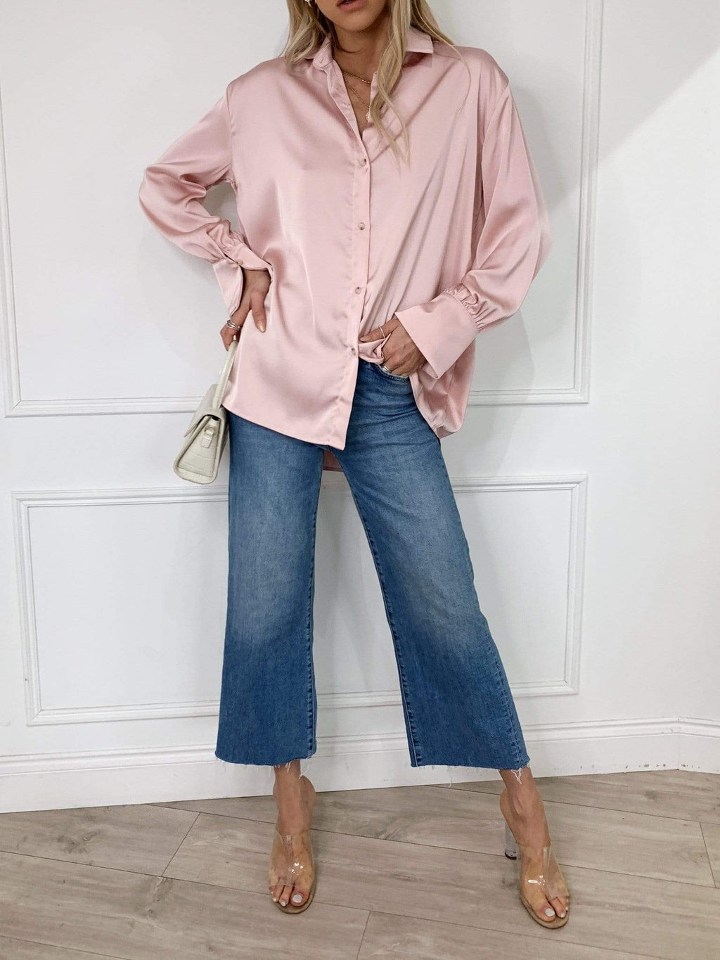 Soft pink shirt from Pretty Lavish is cut from a soft satin material. Designed with fluted sleeves and finished with tortoise shell buttons for those extra loved details. The relaxed silhouette makes this style endlessly versatile. Style yours with jeans or leather trousers.