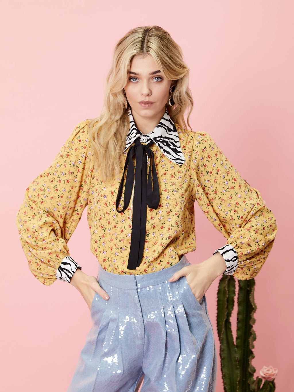 Yellow floral blouse with contrasting zebra print on collar and cuffs from iconic British brand Sister Jane. Playful to wear to the office or to a party. Features a cool skinny neck bow.
