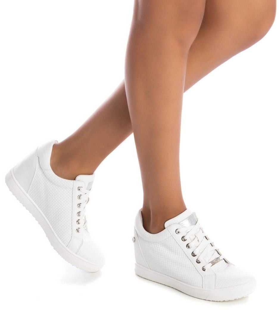 Xti White PU high top sneakers with 5cm inner wedge and cushioned  sole.