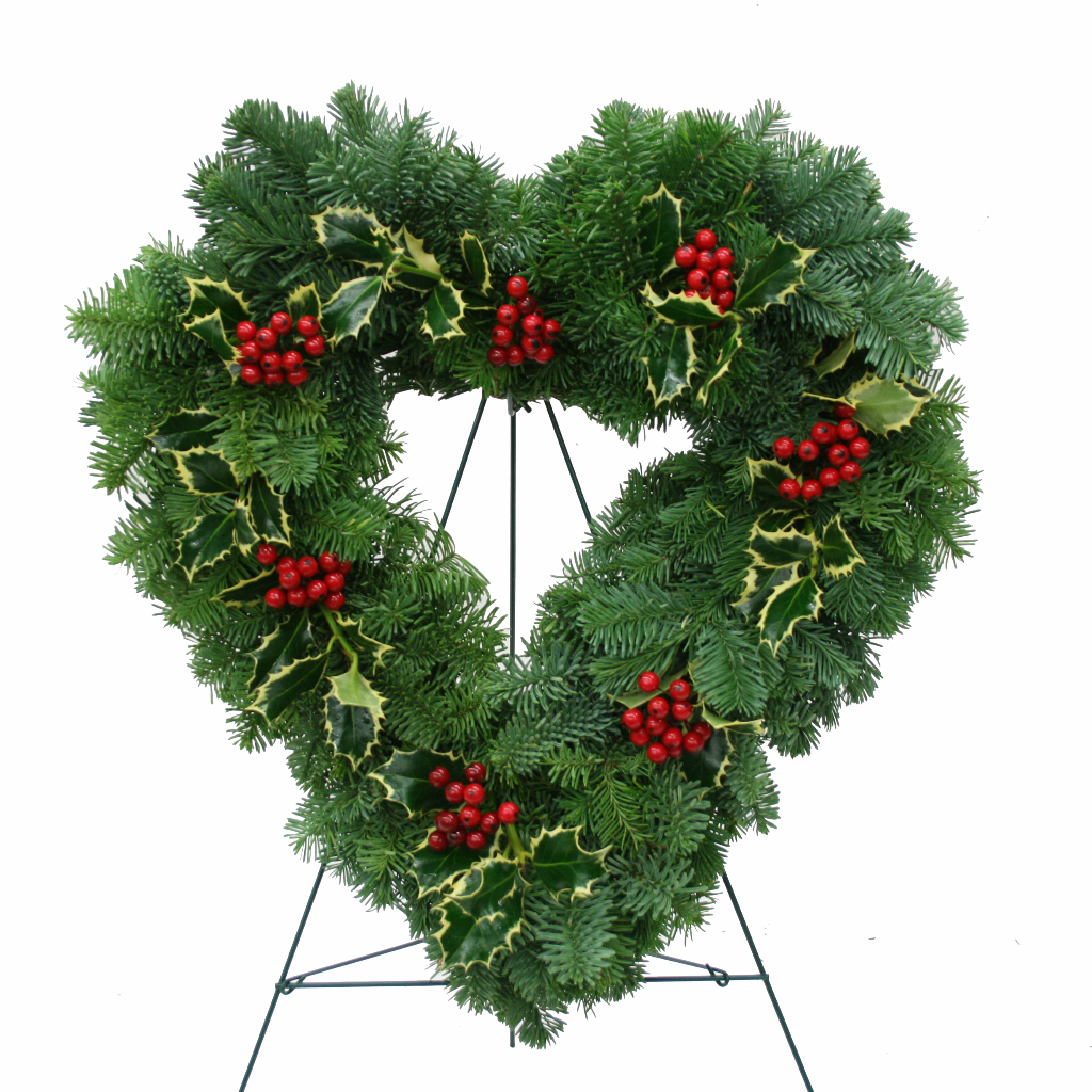 Christmas heart with fir, variegated holly and red berries shown on an easel