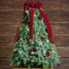 Fresh hand-assembled tabletop Christmas tree with fir, burgundy berry clusters, gold backed burgundy velveteen bow