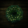 White, globe shaped, cracked glass effect battery operated lights on a evergreen wreath shown illuminated