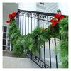 Fresh Douglas Fir Garland hung on wrought iron railing