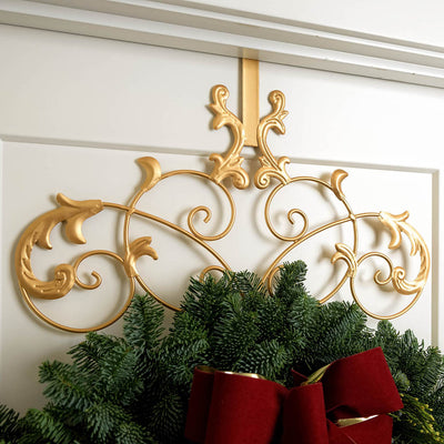 golden baroque styled over the door wreath hanger on white door holding wreath