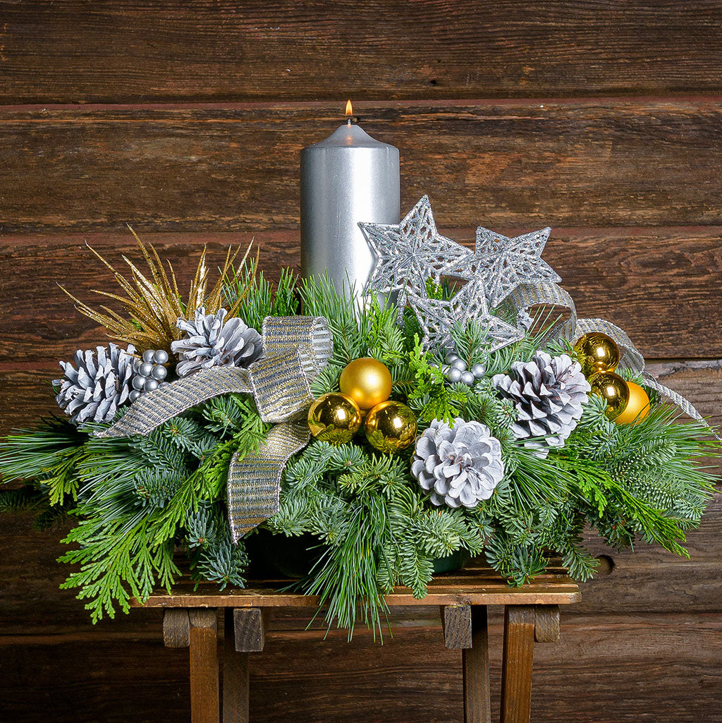 Happy New Year centerpiece has Silver and gold glittery ornaments, metallic bow and a metallic silver pillar candle