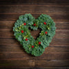 Heart shaped evergreen wreath with variegated holly and red berry clusters