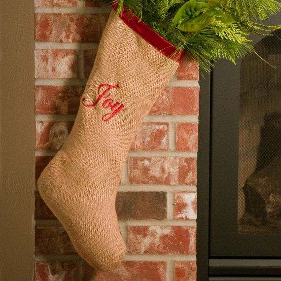 Natural burlap stocking with red embroidered word joy