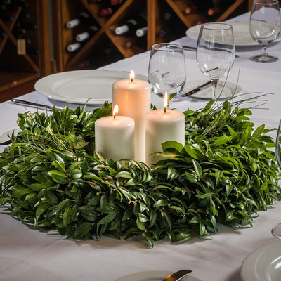 Hand picked fresh salal, green huckleberry and beargrass wreath as a centerpiece with candles