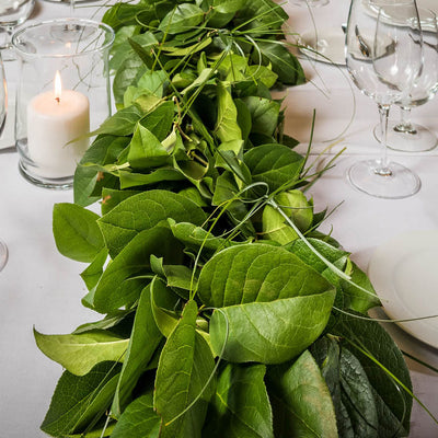 Hand picked fresh salal and beargrass garland as table runner