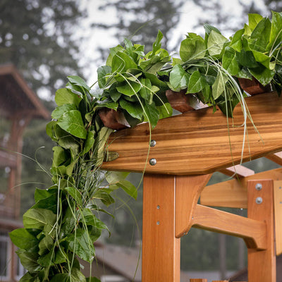 Hand picked fresh salal and beargrass garland on wooden arbor