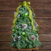 Sprigs of noble fir with frosted Australian pine cones,lime green ball clusters,silver berry clusters & a light green ribbon
