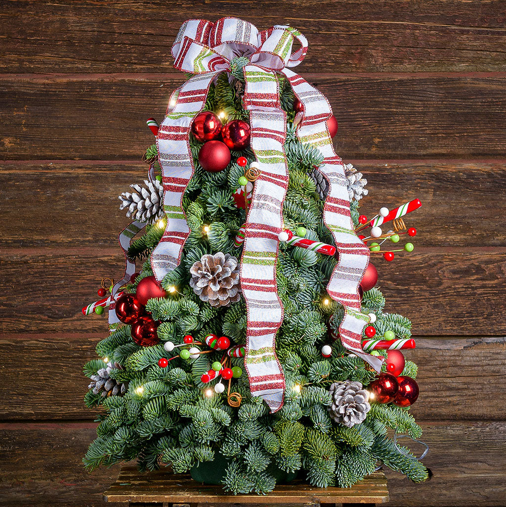 Tree made of noble sprigs with frosted pine cones,red ball clusters,faux candy clusters & a white,red & green glittery stripes
