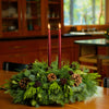 "Centerpiece with bay leaves with 6 egg-sized ponderosa pine cones, 6 burgundy berry clusters and 2 burgundy 12"" taper candles"