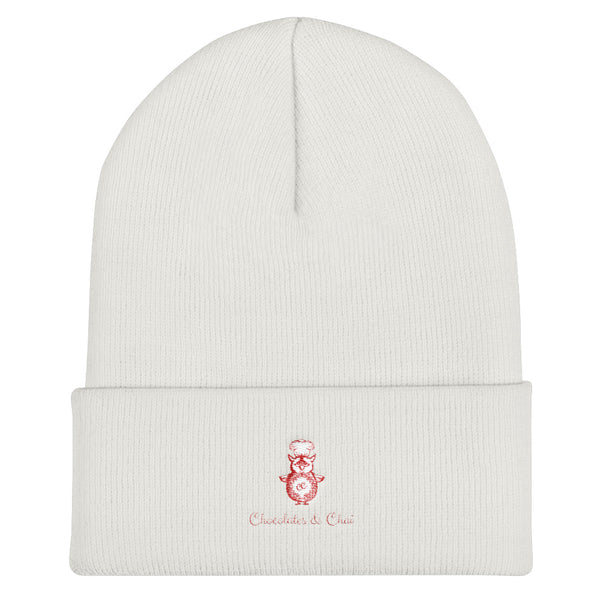 A white beanie with the Chocolates & Chai logo on the fold.