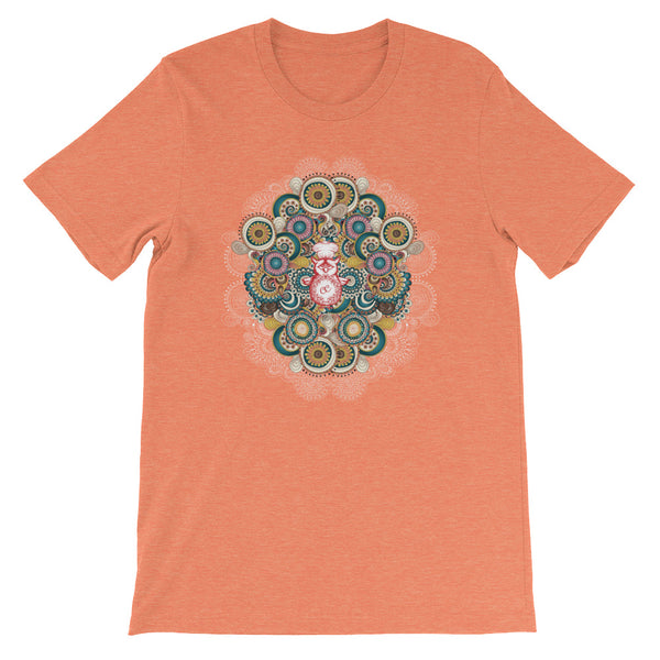 A stunning mandala pattern on an orange t-shirt.