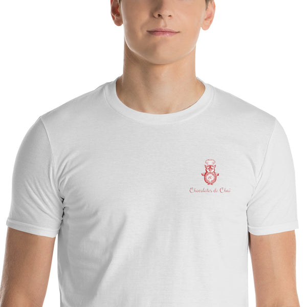 A model wearing a well-fitted white t-shirt with the Chocolates & Chai logo embroidered on the right chest.