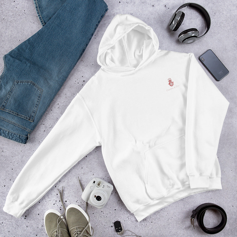 A flatlay showing off the white hoodie with Chocolates & Chai logo.