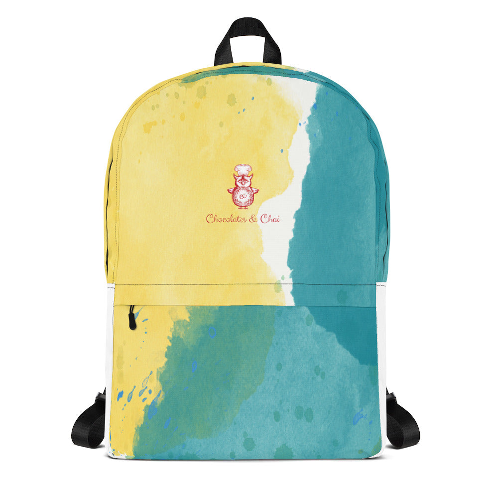 A gorgeous backpack with a yellow and green watercolour design and the C&C logo.