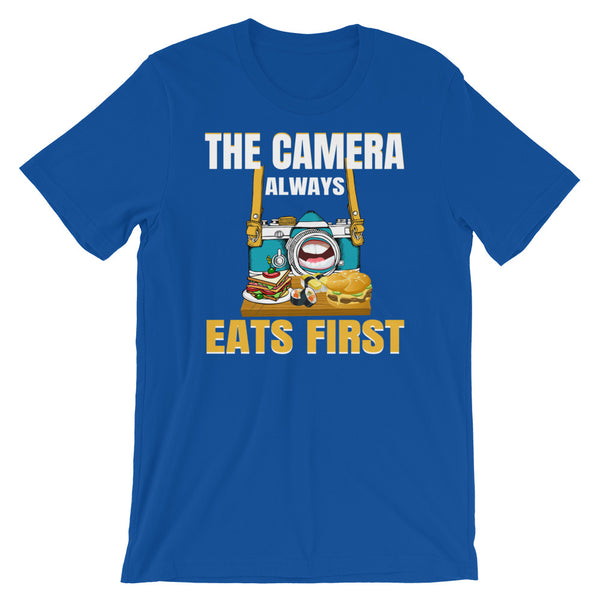 "A blue t-shirt with a picture of a hungry camera eating a platter of food because ""The Camera Always Eats First"""