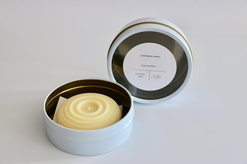 Large Lavender lotion bar with reusable white and gold tin. Ishtahfeetah Soapery.
