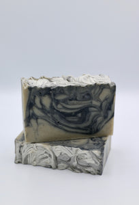Detox. Green Dead Sea mud soap + black activated charcoal swirls. Lavender + bergamot essential oil.