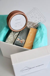 Gift box with three handcrafted soaps, a soap lift, and a mini lotion bar.