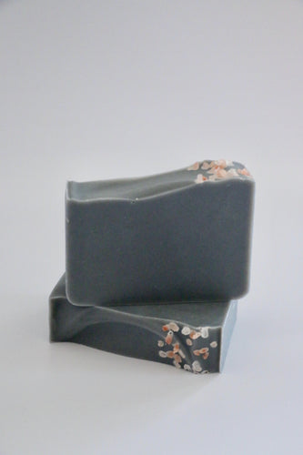 Ishtahfeetah Soapery Solitude handcrafted natural soap. Grey activated charcoal soap topped with pink Himalayan sea salt.