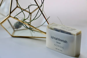 Nordic handcrafted soap by Ishtahfeetah soapery. White soap swirled with blue indigo + French green clay.