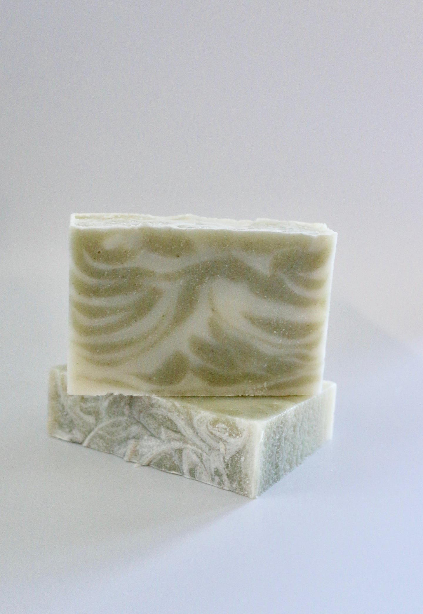 Green and white swirled natural handcrafted soap. Unscented.