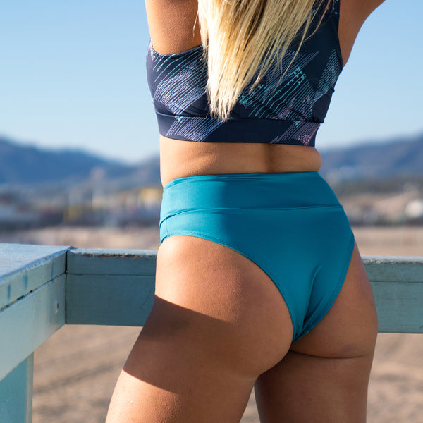 Eco Friendly High Leg Surf Bikini Bottom in Tahitian Tide Teal With +50 UPF - Anowi Surfwear