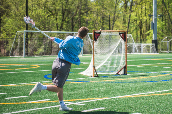 Professional lacrosse player, Bryce Wasserman shooting a lacrosse ball with an ECD lacrosse stick
