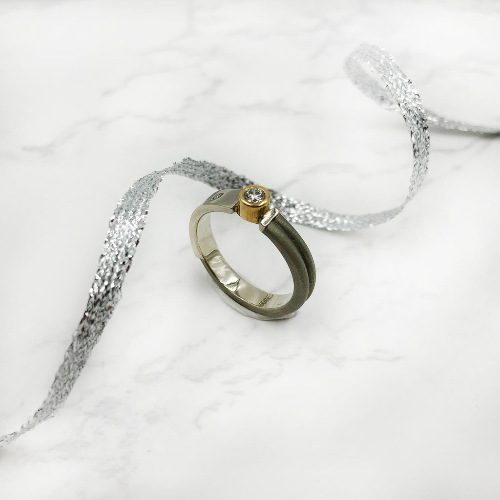 Stephen Dixon - Two Textured Round Diamond Setting
