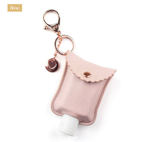 Itzy Ritzy Hand Sanitizer Clip- Blush and Rose Gold