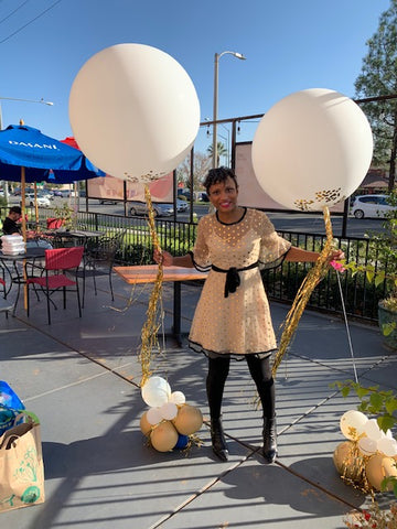 Kristy Cooper The Fancy Mom with Stars Above Balloons display