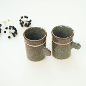 A set of 2 handmade Japanese tea cups in green wasabi design. Pay less when enjoying it for two.