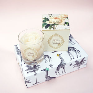 white rose scented container candle. a luxurious gift