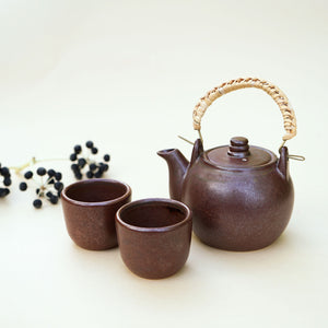 Handmade small Chinese teapot with 2 cup in rustic in minimalism and effortless design.