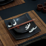 It is an art of dining. Serving a meal could be more fun with this square plate set in black glaze with Japanese motif design. They are handmade with hand finished from a local pottery. Each plate is unique with its own character.