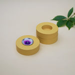 Mustard donut wooden tealight holders. Perfect with one on its own or stacking them to add dimension to the look.