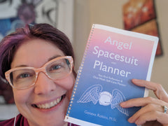 https://www.theangelspacesuit.com/products/digital-download-angel-spacesuit-mini-planner-year-end-reflection-one-week-self-care-plan