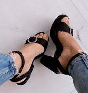 Black buckle up heels